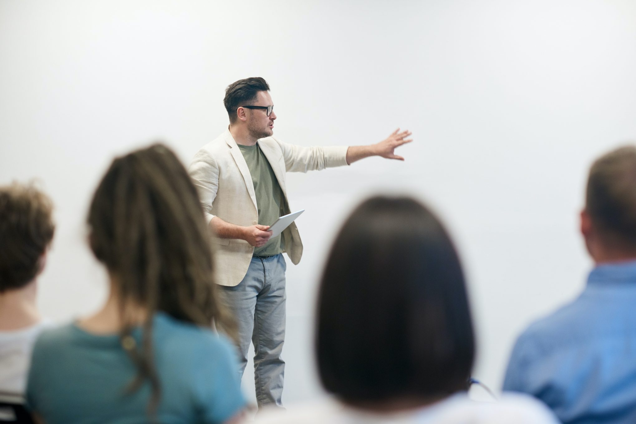 Man with glasses teaching class